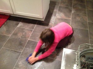 My daughter cleaning up a spill