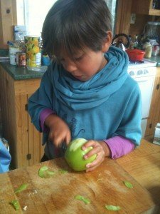 My niece preparing apples for crisp